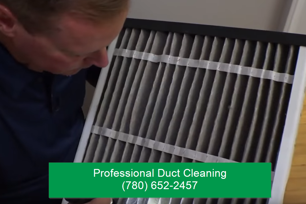 professional duct cleaning guy inspecting vent in edmonton